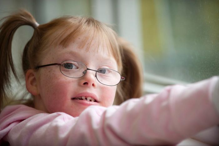 Sophie now regularly uses programs and games on a tablet to help improve her literacy. Photo credit: www.abc.net.au