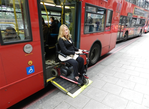 Laura Hamilton exits a double-decker bus in London. (Photo credit: Courtesy of Laura Hamilton)