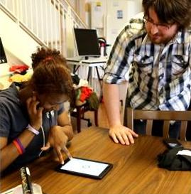 Drexel computer science senior Nate Vecchiarelli (right) was part of a senior design group that developed and implemented smartphone apps to aid students with vision disabilities at Overbook School for the Blind.(Photo credit: Drexel University)