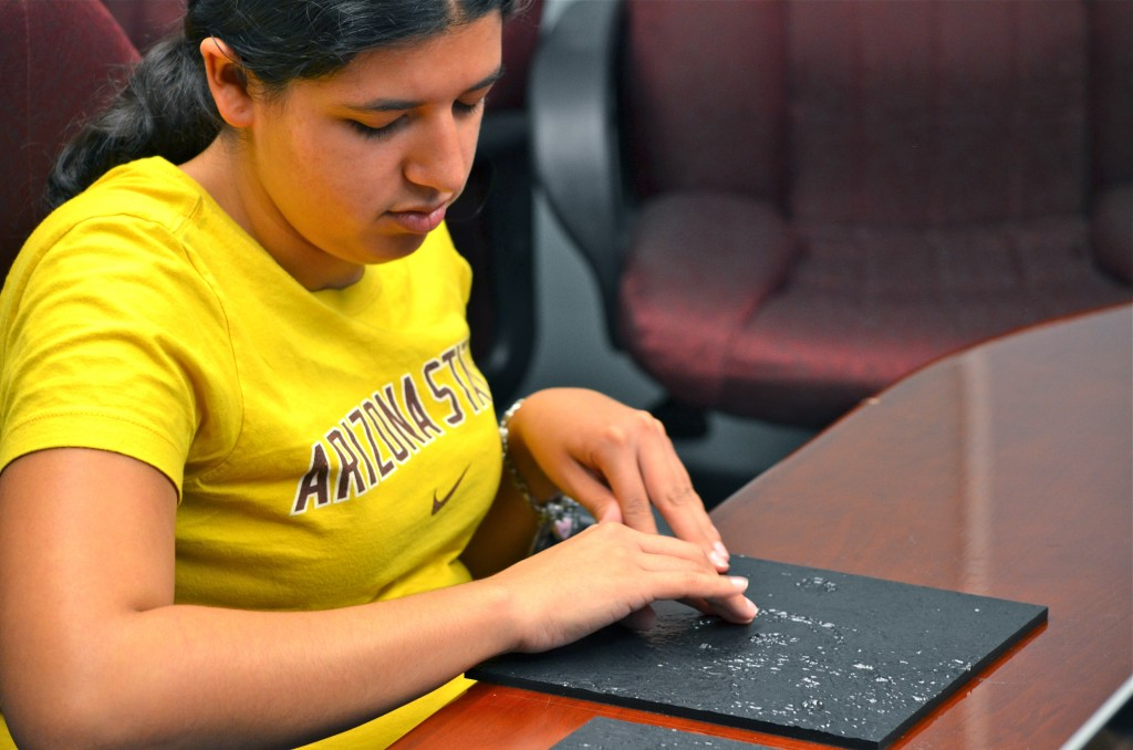 ASU senior Ashleigh Gonzales tests new 3-D tactile boards that will be used in basic STEM courses. Gonzales, who is blind, is part of an ASU research team developing the materials. (Photo credit: Jacob Mayfield, ASU)