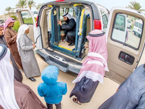 People with mobility disabilities check a vehicle specially designed for them during a ceremony organized to deliver such vehicles to them in Riyadh. (Photo credit: Saudi Gazette)