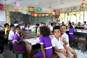 Students of Sigatoka Methodist Primary School enjoying their newly renovated classroom with AusAID funding which was damaged by flooding in April 2012. (Photo credit: Maggie Boyle / AusAID)