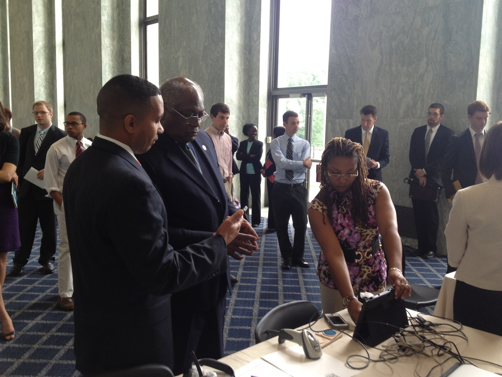 Juan Gilbert shows U.S. Rep. James Clyburn the Prime III accessible voting technology. (Photo credit: Katy Bayless Gibson Clemson University)