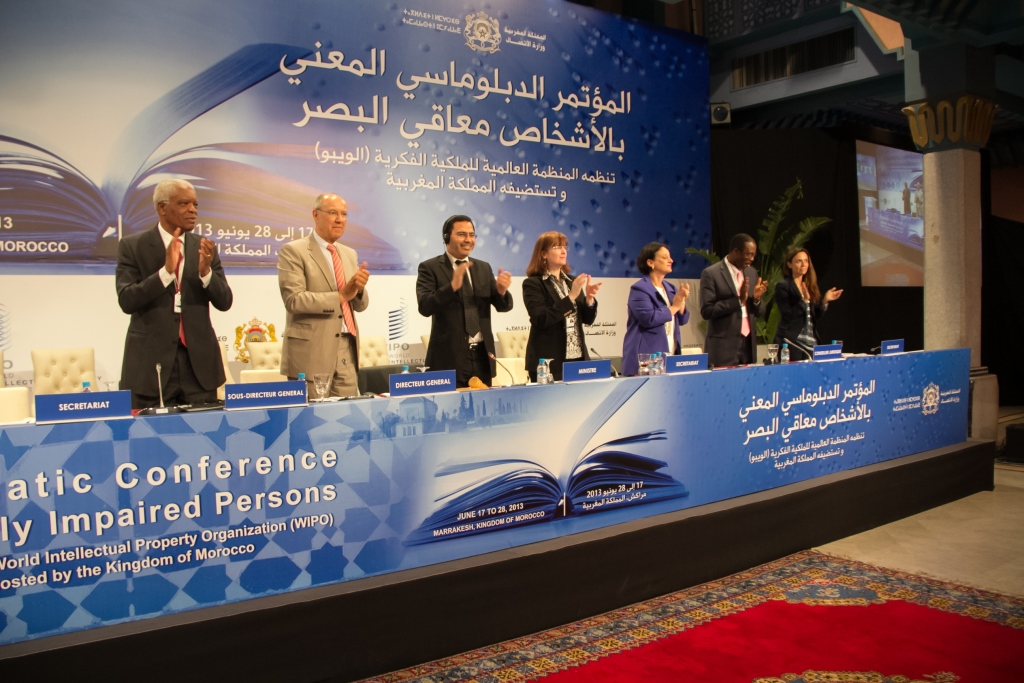 WIPO Director General Francis Gurry (second from left), Morocco's Minister of Communications and Government Spokesperson Mustafa Khalfi (third from left), and members of the WIPO Secretariat applaud adoption of a new international treaty that will facilitate access to published works for people who are blind, VI and print-disabled. (Photo credit: Avant Scene / Hicham Rachidi ©WIPO)