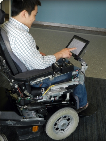 Assistive wheelchair tray 'RoboDesk' could help people use mobile devices more easily. Photo: Purdue Research Foundation