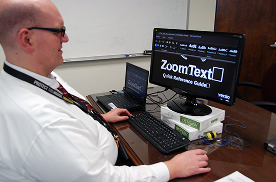 Bernard Werwie, a Defense Logistics Agency contract specialist, uses Zoom Text, a screen enlarger, to test the compatibility of software for users with disabilities. The Defense Department's Computer/Electronic Accommodations Program provides workplace accommodations for people with disabilities. Photo DOD Amanda Neumann