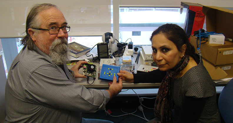 Senior Lecturer Dr Iain Murray and PhD student Azadeh Nazemi developed a digital reading system for people who are blind, allowing them to read graphical material. Photo: Curtin University