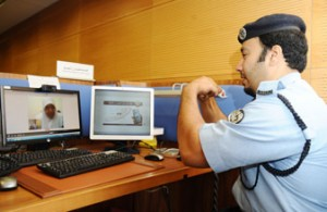 A policeman interacting with a person with hearing disability via the system.