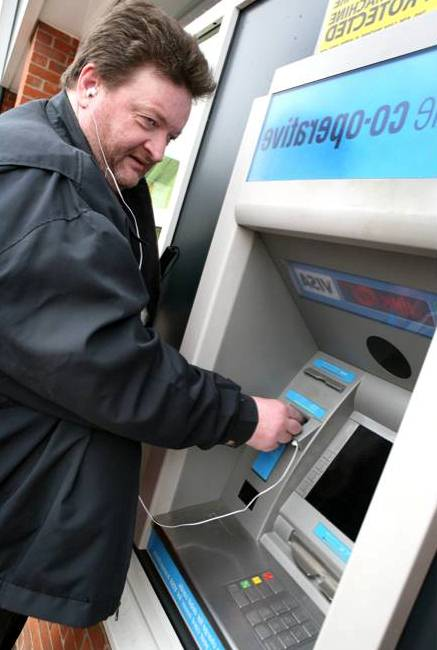 A customer using the Co-operative Bank's new talking ATM machines. (Photo credit: Co-operative Bank)