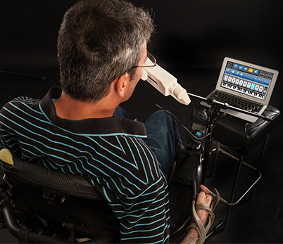 Man with disabilities uses Assistive Technology