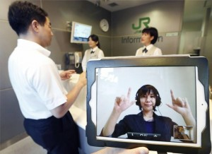 Japan Railway operator uses sign language Monday on an iPad screen in Shinagawa Station as the railway began testing a new service for people with hearing disabilities. (Photo credit: KYODO, Japan Times)