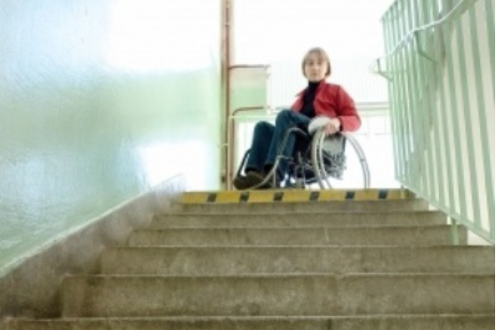 Lady in wheelchair at top of stairs unable to exit building