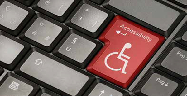 Image of a computer keyboard, and the enter key has been replaced by a red button with the International Symbol of Access (wheelchair logo) and the word Accessibility .