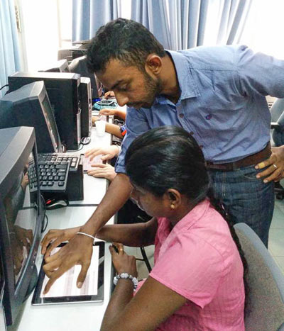 A touchscreen Braille app undergoes testing in Sri Lanka. Photo Sohan Dharmaraja