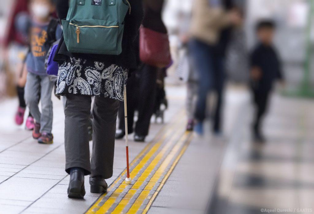 Blind Woman Walking on Tactile Paving