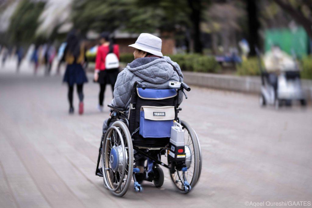 Wheelchair user in Tokyo street