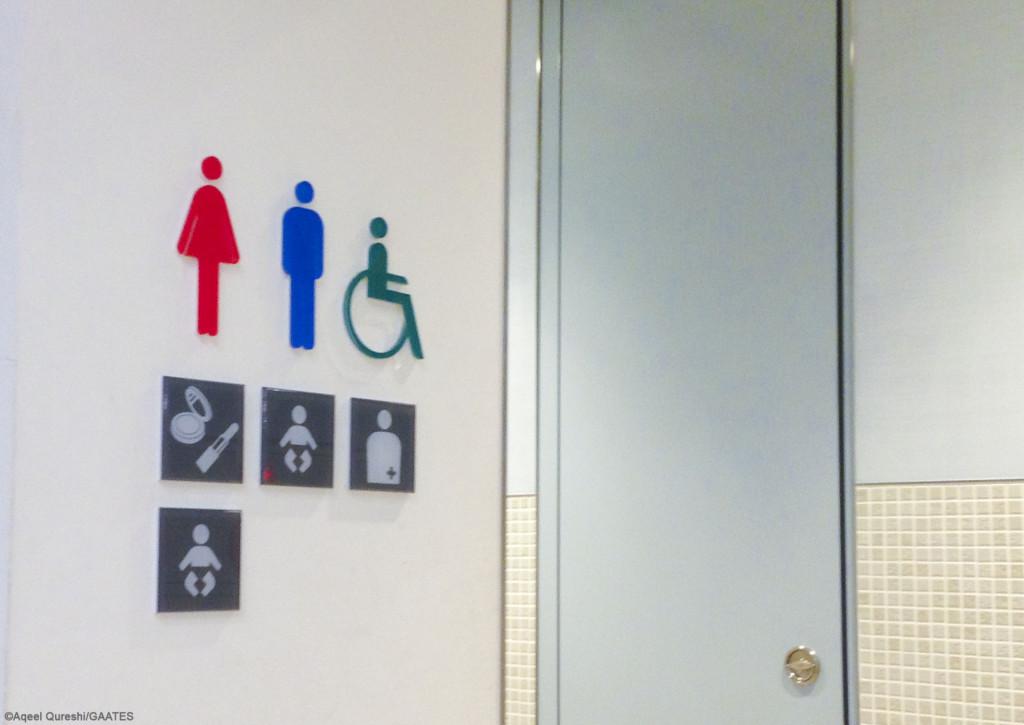 unisex accessible toilet signage