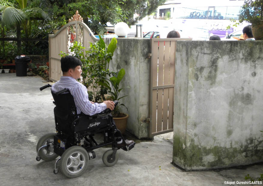 Wheelchair User leaving the building in kuala lumpur