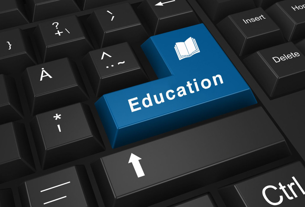 Concepts of online education, with message on enter key of keyboard.