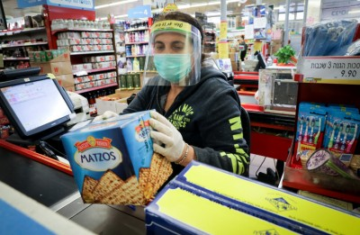 Woman cashier wearing a face mask