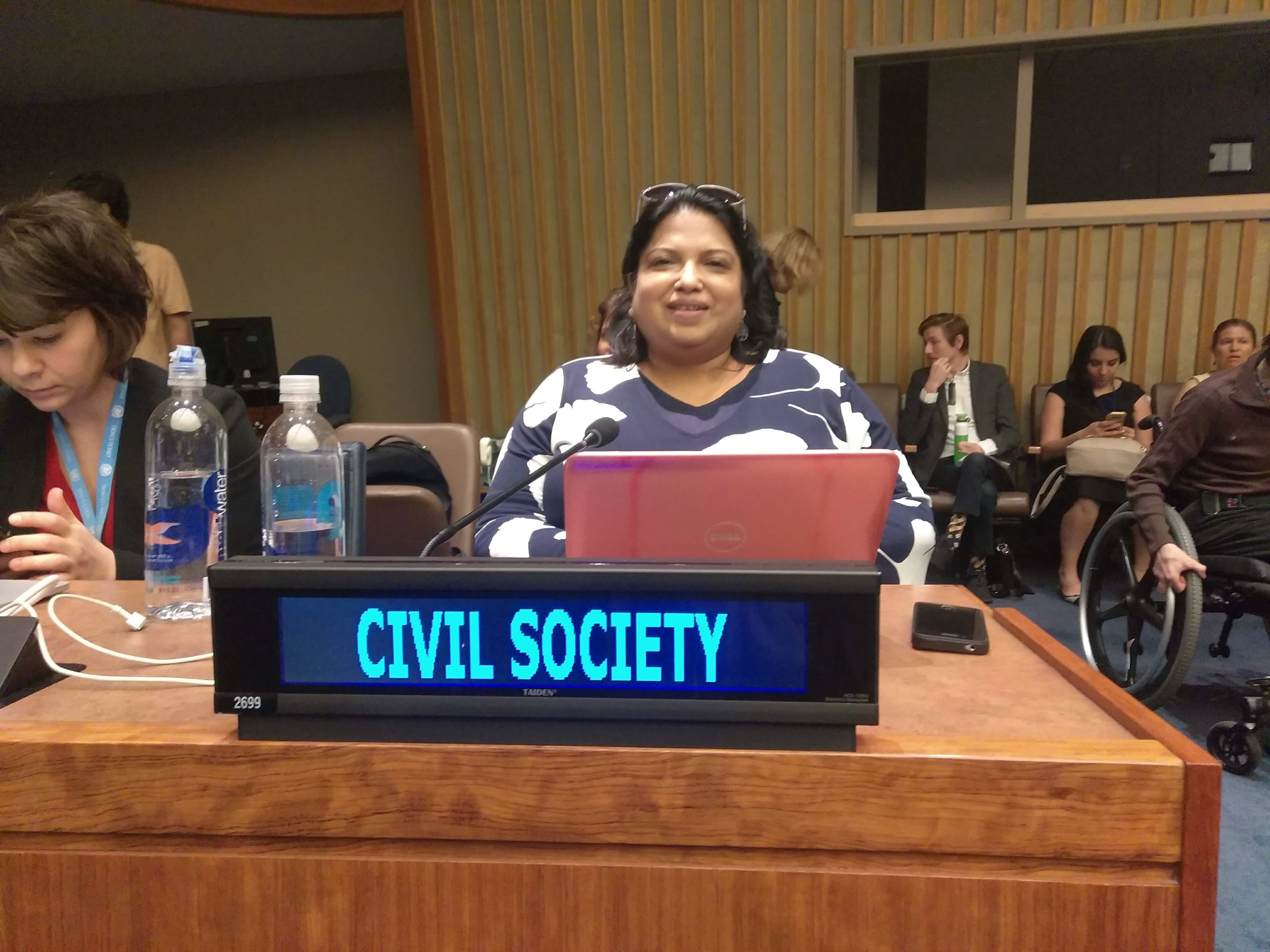 Photo of GAATES Board Member Anjlee Agarwal smiling and sitting in Conference Room, representing Civil Society