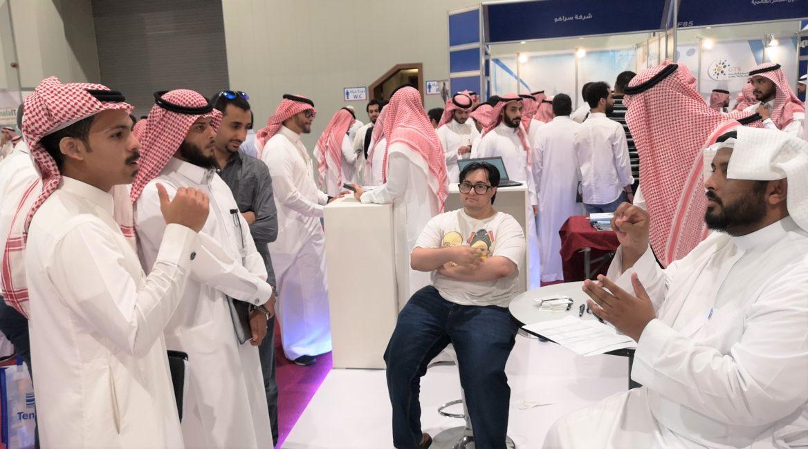 candid of participants chatting at a job fair