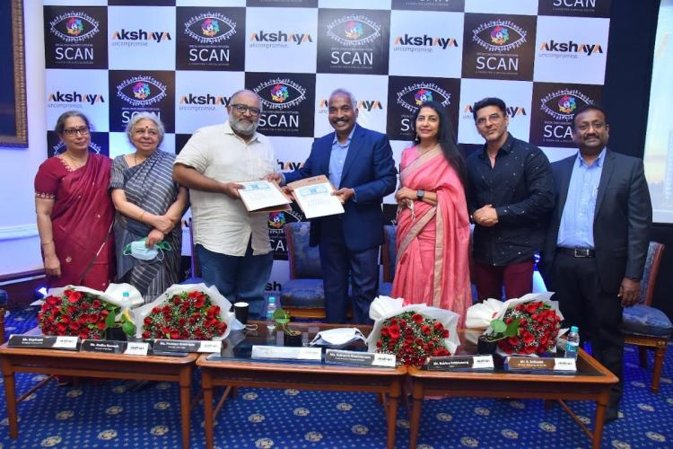 Photo of members of Special Child Assistance Network (SCAN), has tied up with real estate developer Akshaya Private Ltd signing an MoU at an event