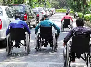 three persons on wheelchairs photo taken from behind