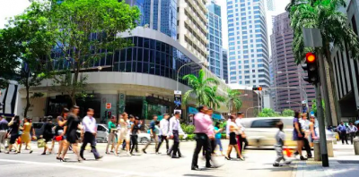 Unidentified businessmen crossing the street in Singapore. (Image by Joyfull / Shutterstock.com)