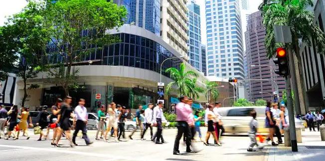 Unidentified businessmen crossing the street in Singapore. (Image by Joyfull / Shutterstock.com)