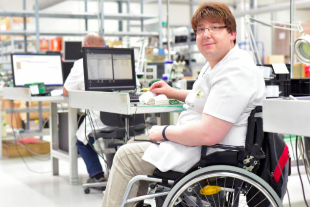Person on a wheelchair looking into the camera