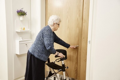 Older woman opening the door