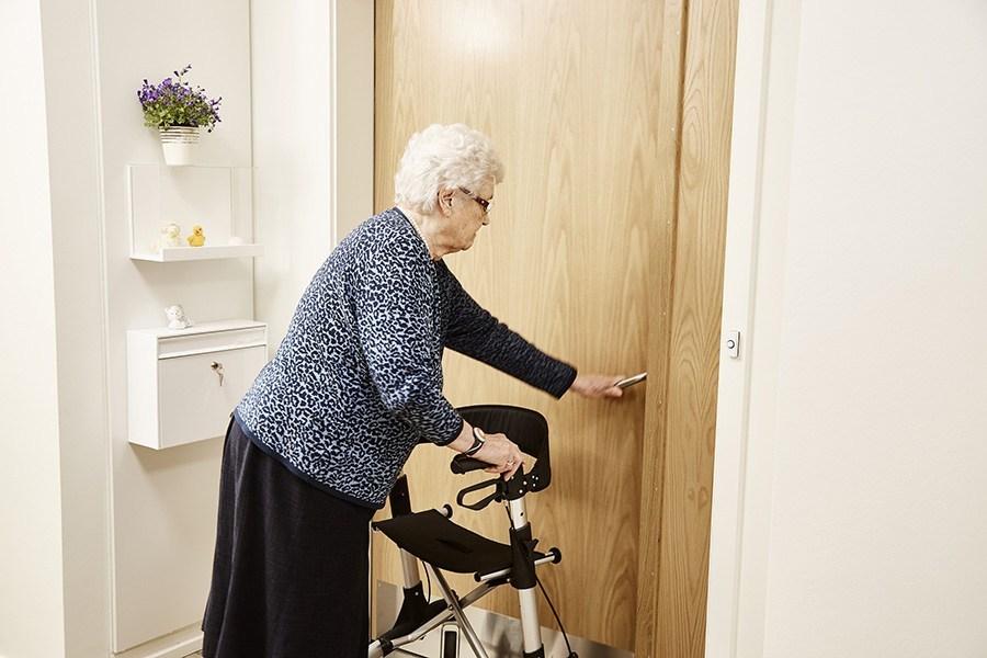 Older woman opening the door