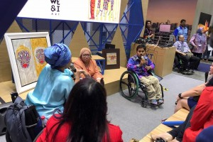 Photo of two Local Malaysian Artist with disabilities, presenting their art and discussinf struggles of being an young artist and an artist with a disability during the City in the Mirror Event at the Next City World Stage.