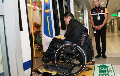 A person on a wheelchair getting into the metro