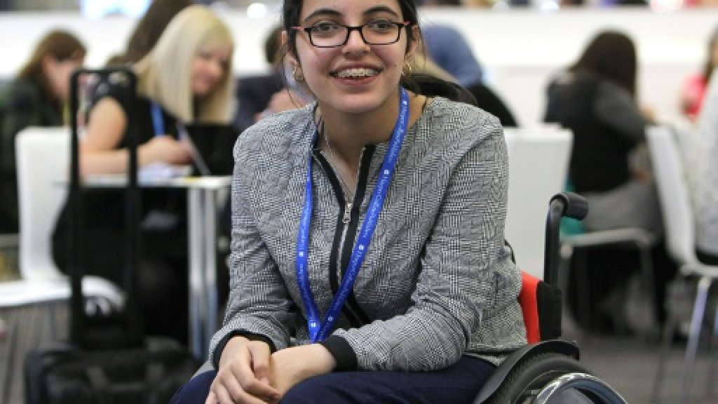 smiling girl on a wheelchair