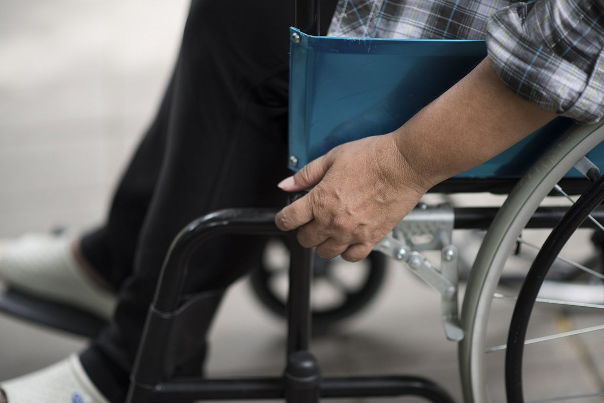 A Person in a wheelchair. This picture is illustrative.