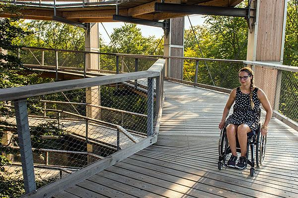 Young lady in a wheelchair on a wooden ramp