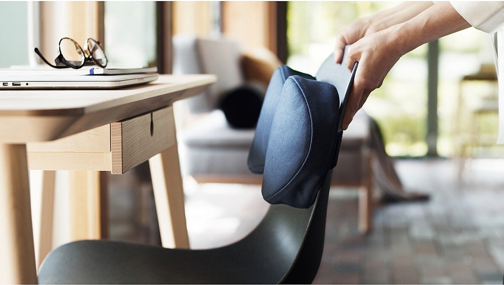 persons pulling out a chair from the table