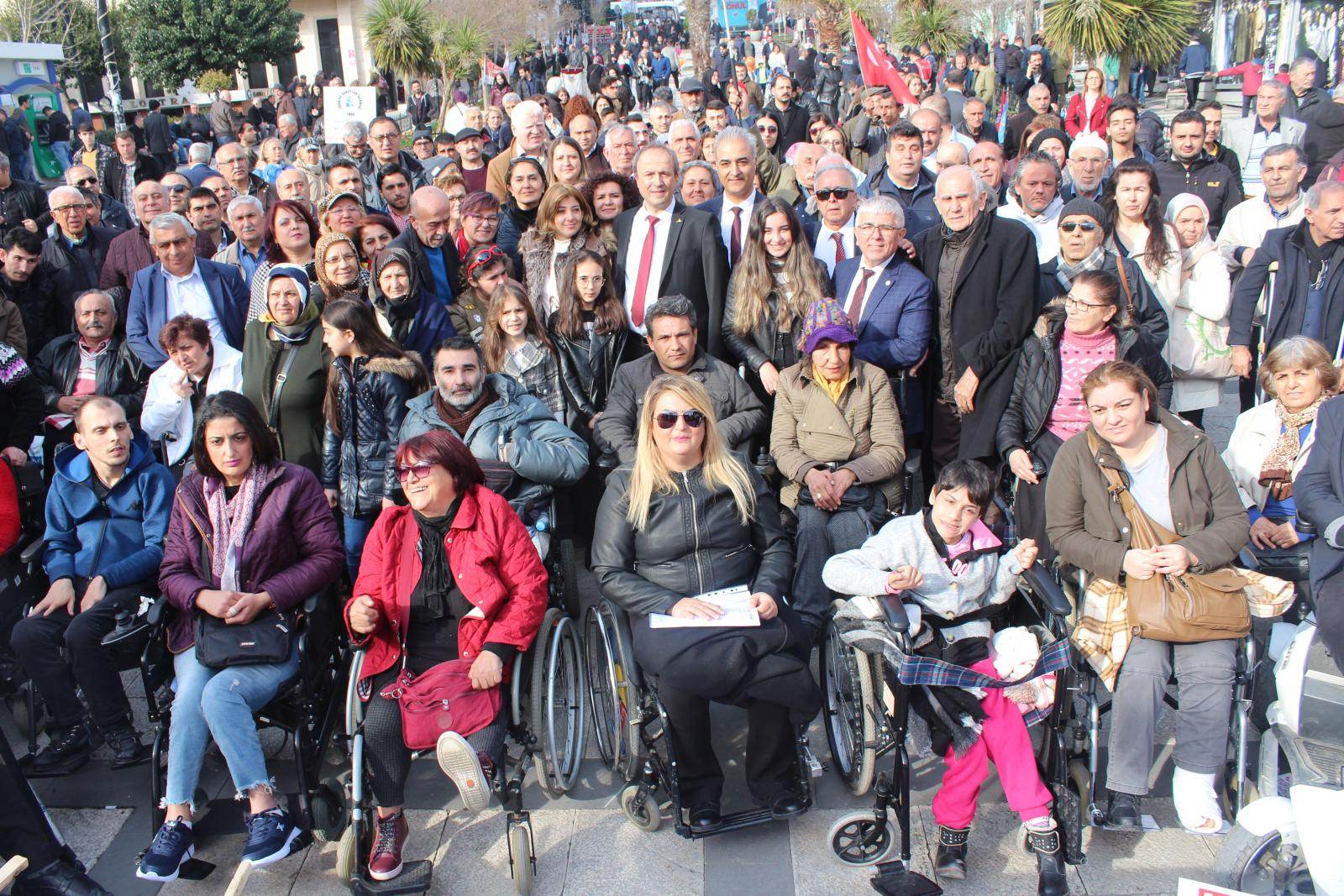 Group of persons with disabilities posing for a camera shot
