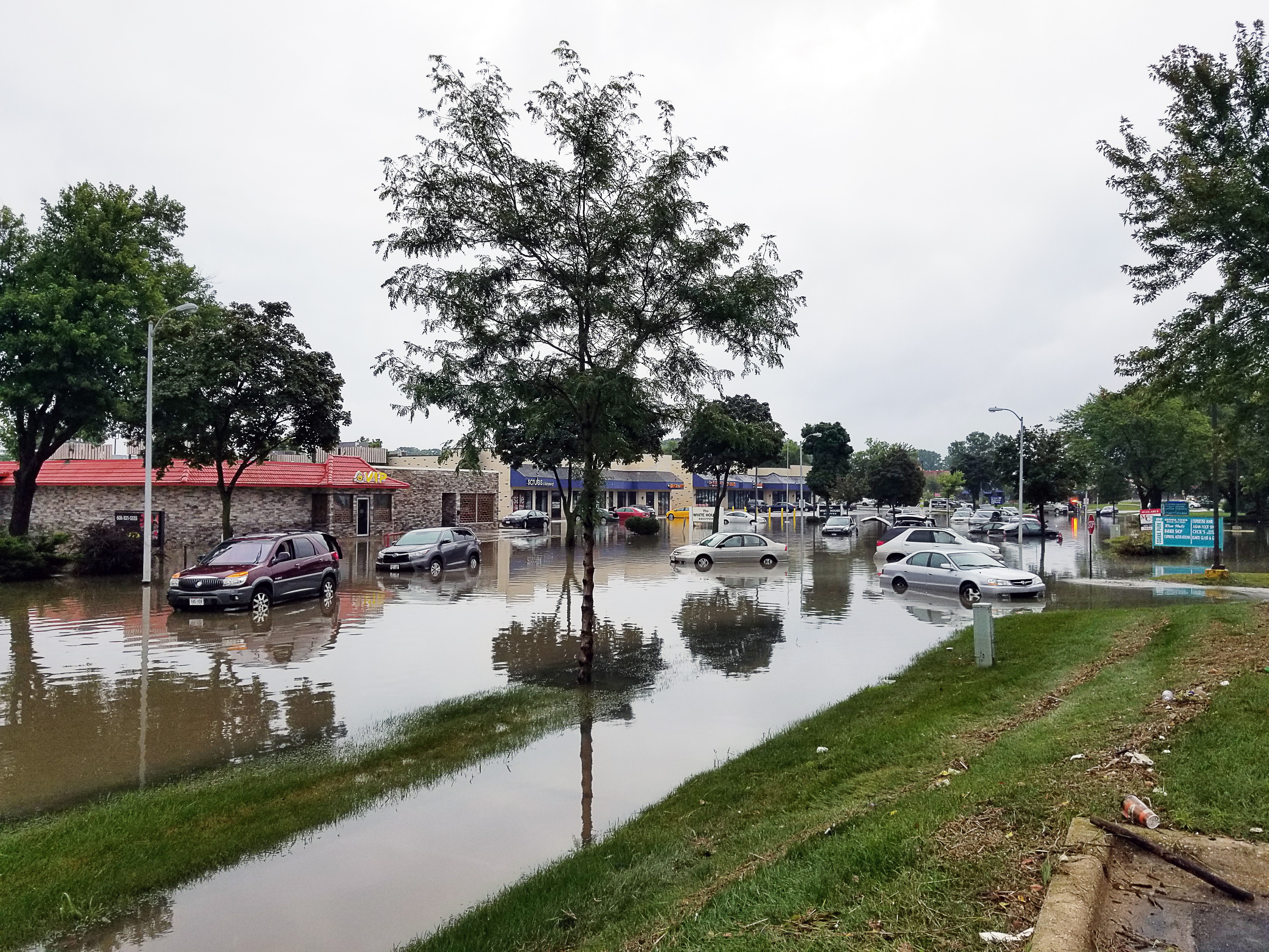 flooded street with parked cars