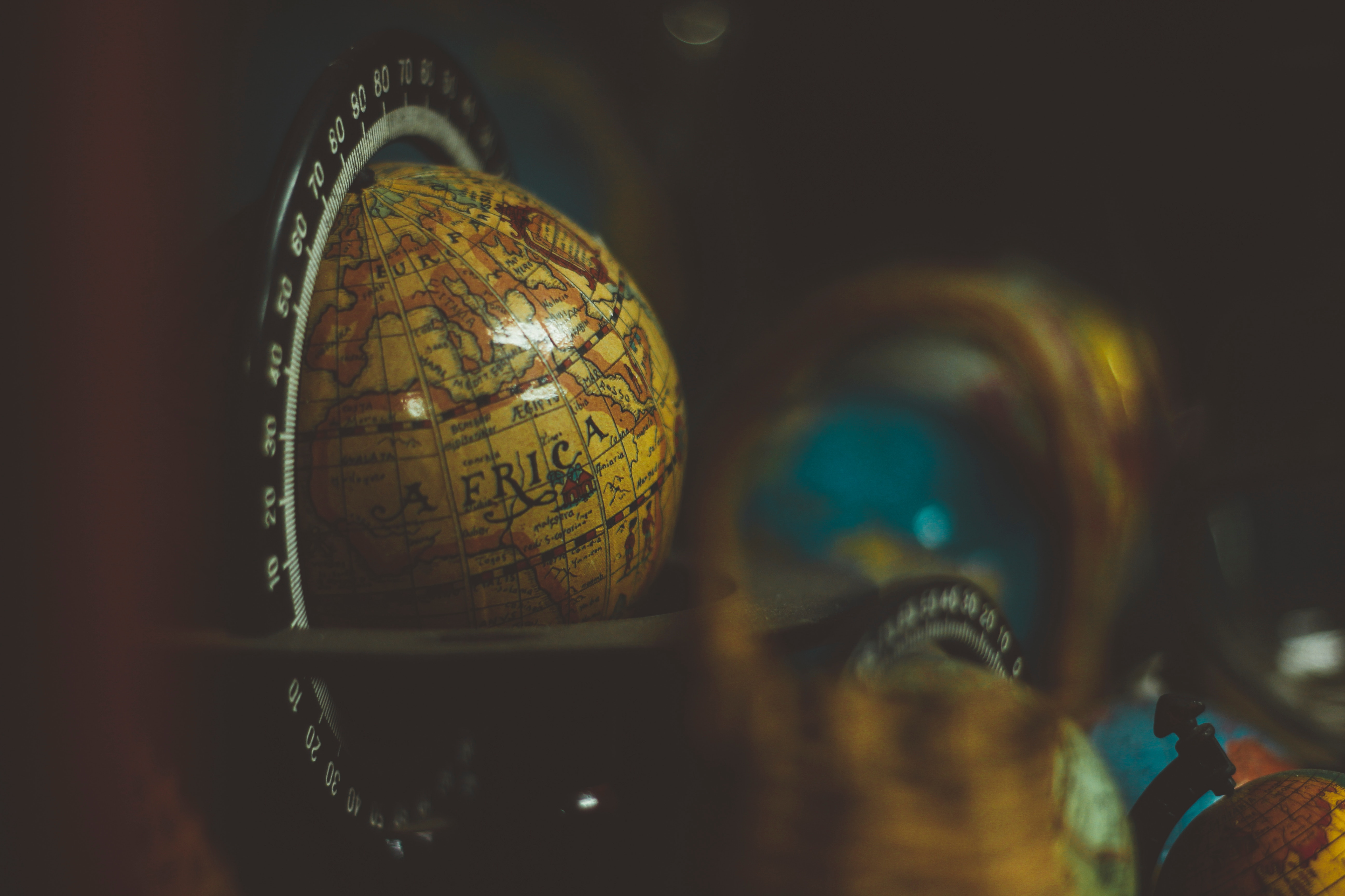 Photo of Africa on a globe with other globes blurred in the background
