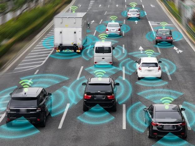 Image depicting cars on the road with the wifi sign symbolising connected to each other.