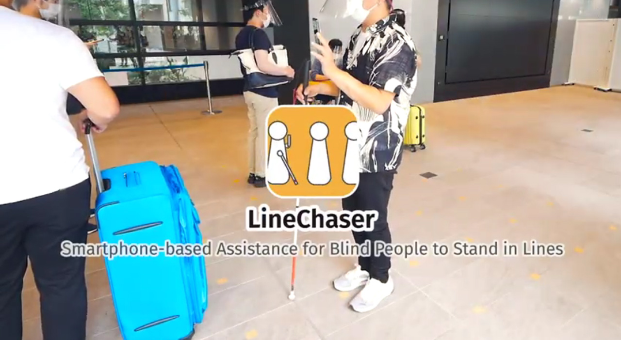 LineChaser - Smart Phone Based assistance for Blind People to Stand in Lines written against a photo of a person with visual impairment standing in a line.