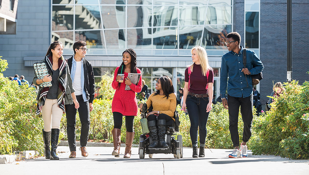 Group of students with one lady on a wheelchair.