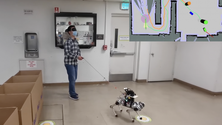 Person with Visual Impairment using a prototype robodog.