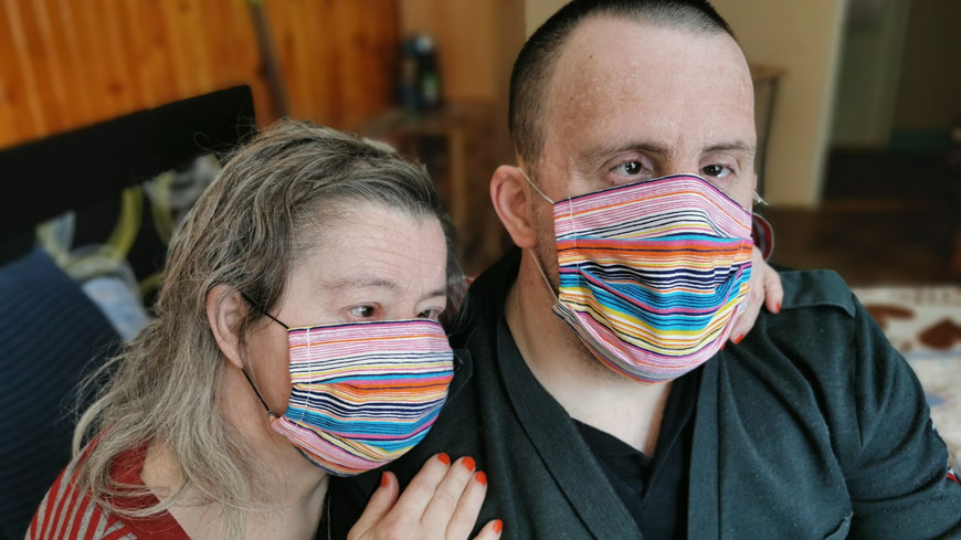 A man and a woman with masks on during the coronavirus crisis